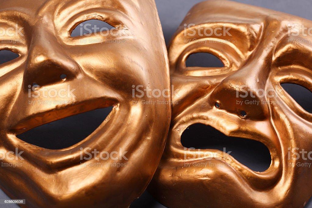 Gold theater masks stock photo