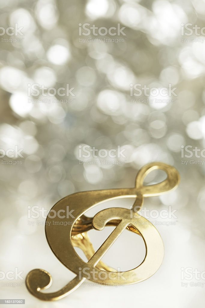 Gold Treble Clef Infront Of Defocused Lights stock photo