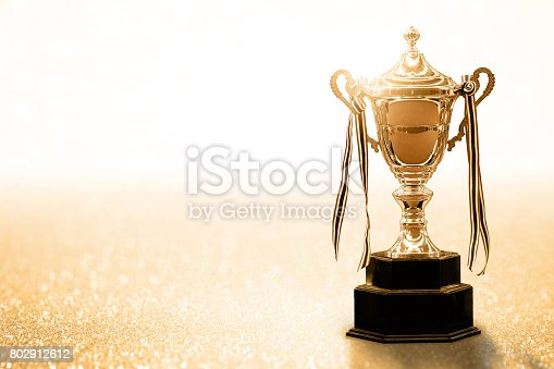istock Gold Trophy competition on the abstract glitter background with copy space 802912612