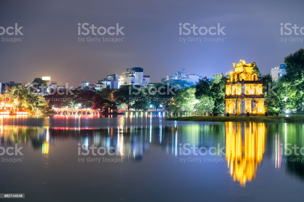 Gold Turtle tower with The Huc red bridge in Hoan Kiem lake at night stock photo