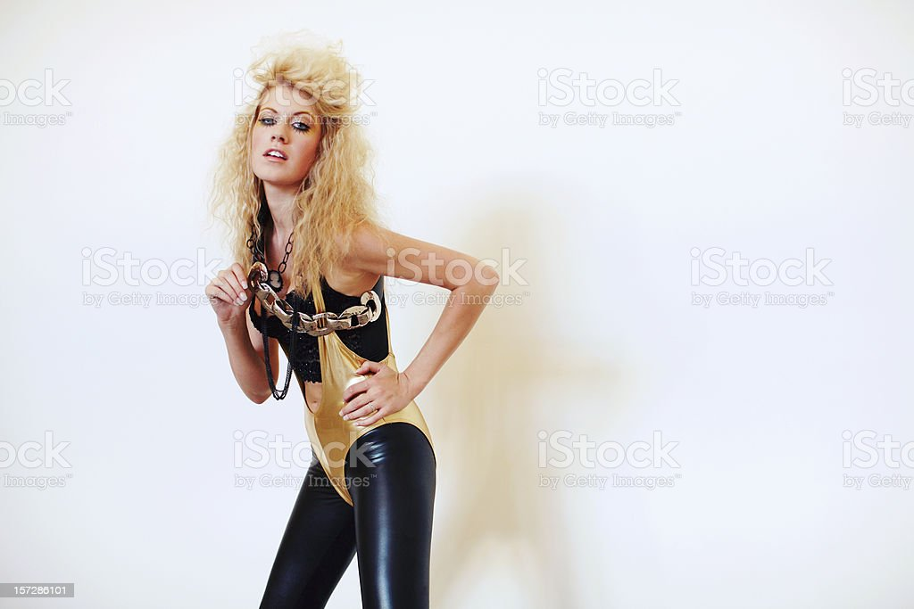 Gold Unitard Blonde Woman with Chains and Necklace royalty-free stock photo
