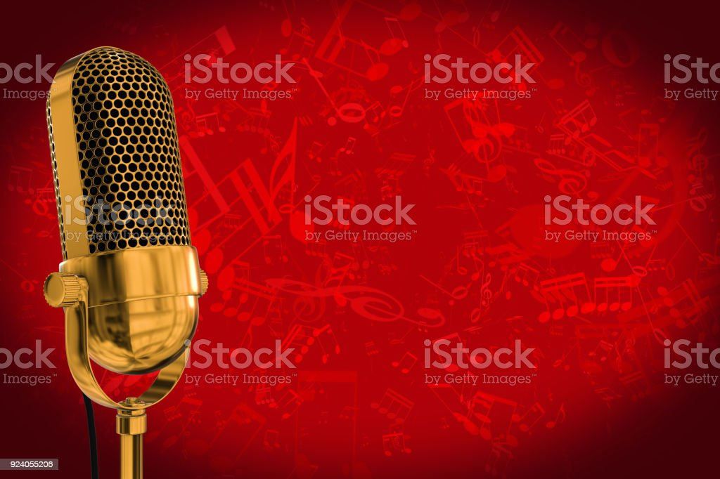 Gold vintage microphone with a red background and music symbols stock photo