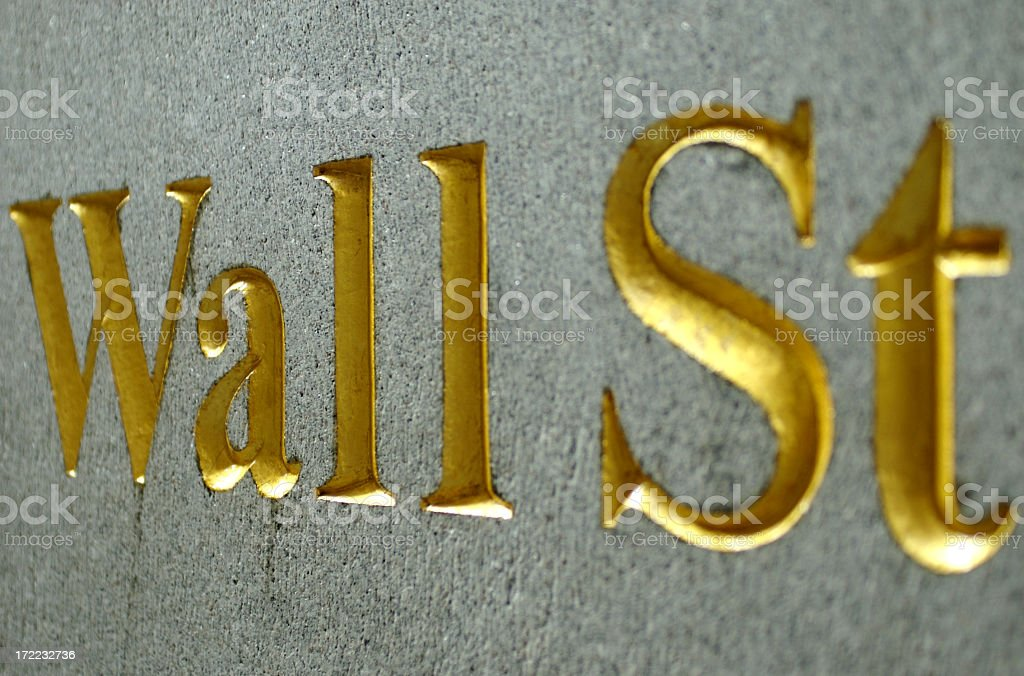 Gold Wall Street Sign Carved in Stone royalty-free stock photo