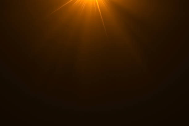 gold warm color bright lens flare rays light flashes leak movement for transitions on black background,movie titles - multi layered effect stock pictures, royalty-free photos & images