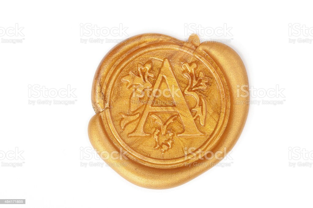 Gold wax seal isolated on white stock photo