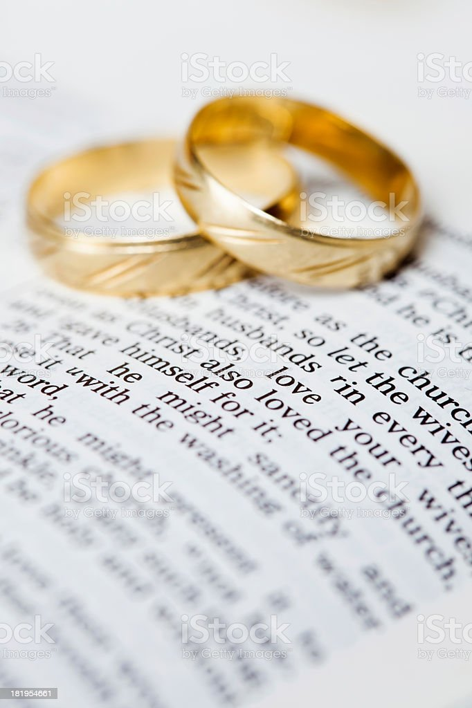 Gold wedding bands placed on a King James Version Bible royalty-free stock photo