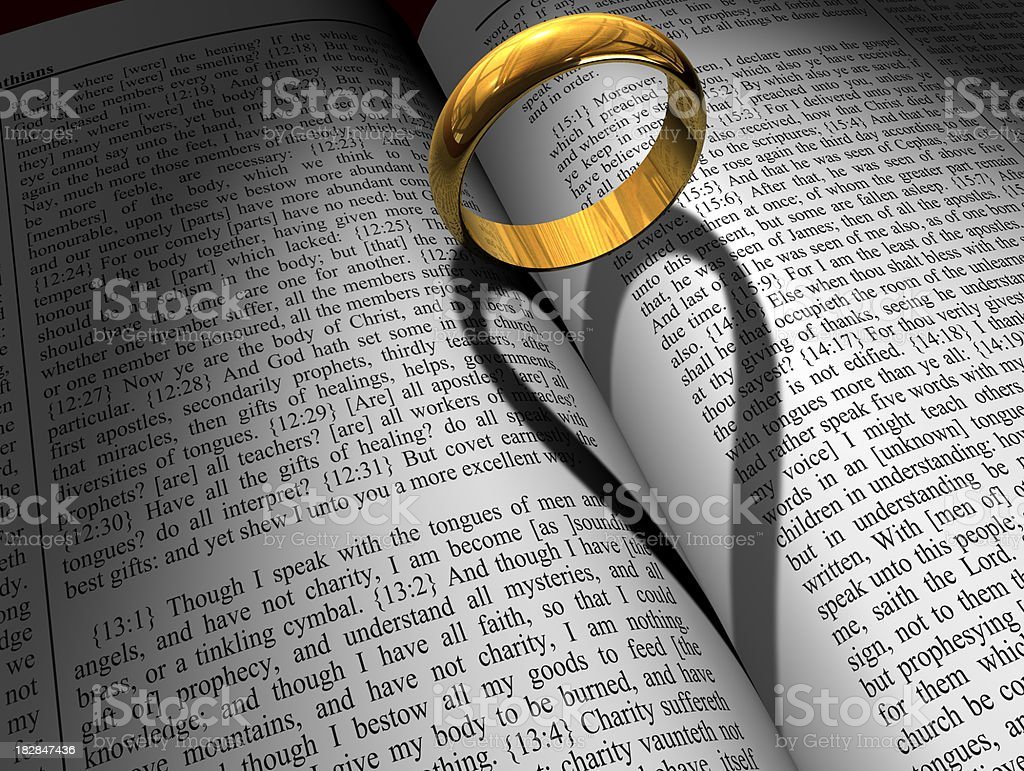 Gold Wedding Ring and Bible stock photo