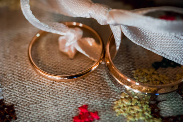 gold wedding rings closeup on the fabric in a rustic style stock photo