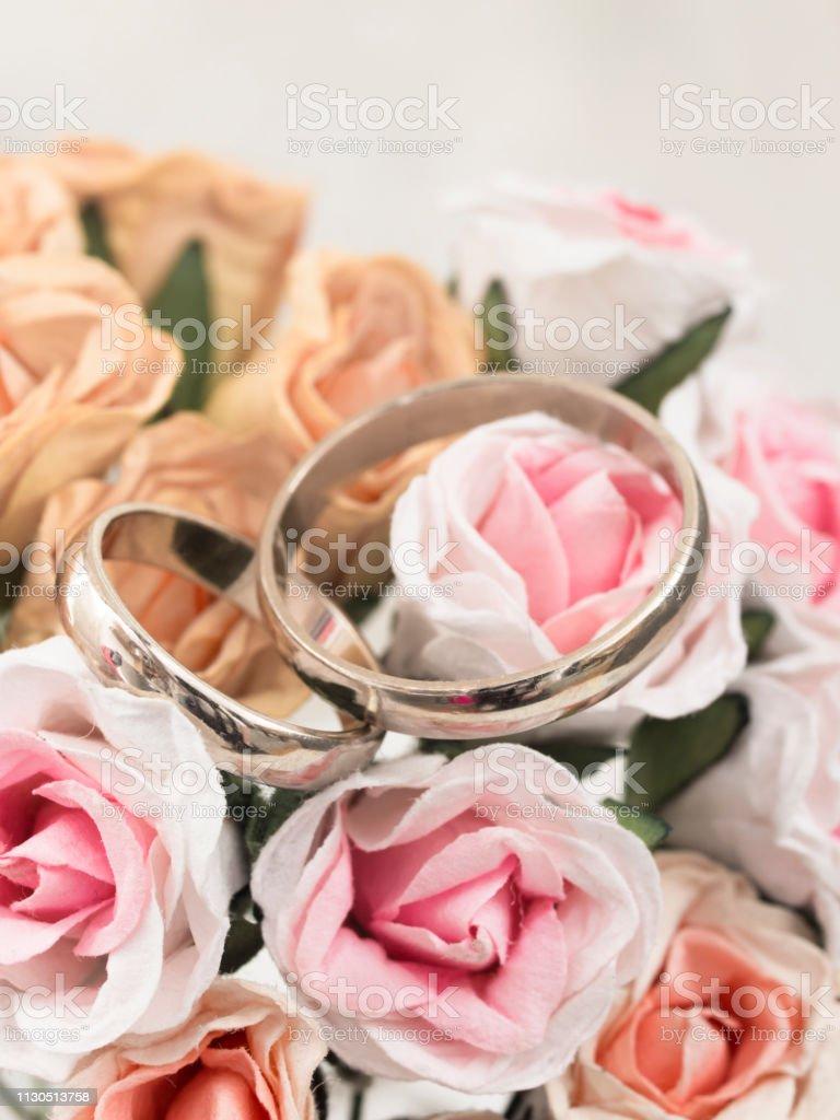 gold wedding rings in elegant arrangement stock photo