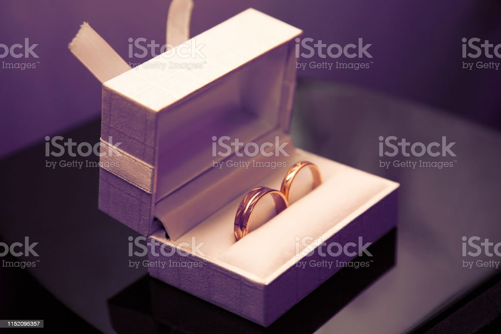 gold wedding rings lie in a box. love and family relationships