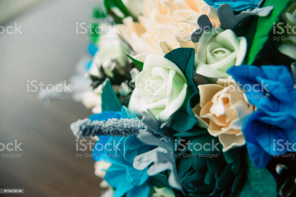 Gold Wedding Rings On Brides Bouquet Of White And Blue Roses Wedding