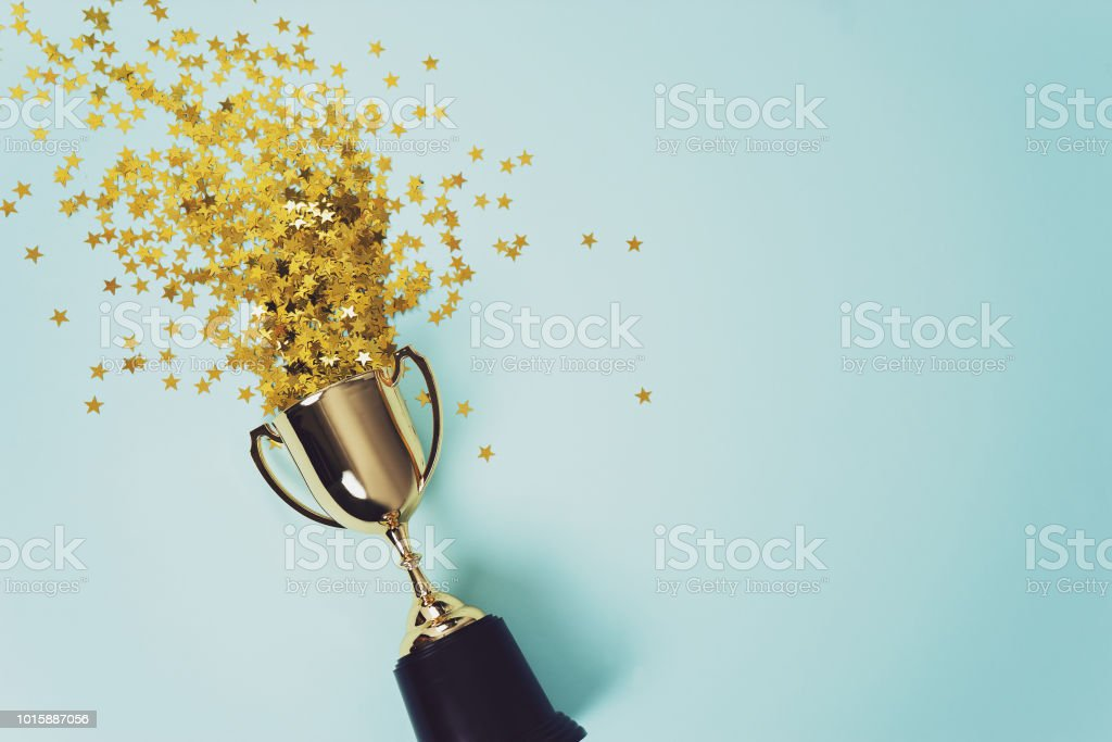 gold winner cup on blue  background stock photo