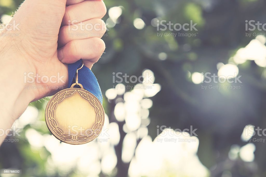 Gold winning medal stock photo