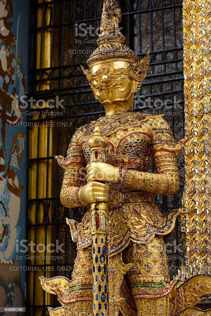 Gold yaksha demon at Phra Mondop library at Grand Palace stock photo