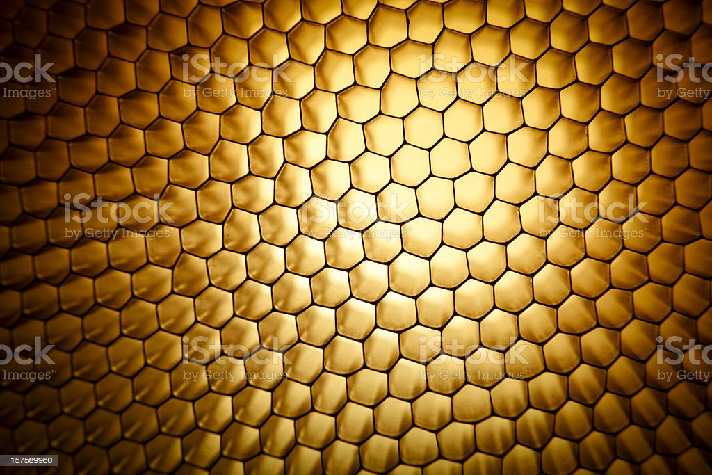 Gold yellow honeycomb grid mesh background texture stock photo