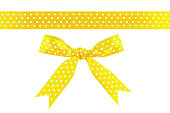 istock Gold yellow ribbon and bow isolated on white background 1158643671