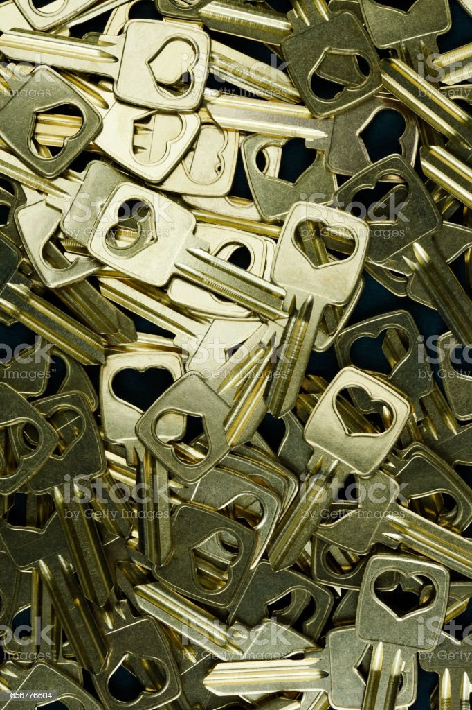 Gold-colored key blanks. stock photo