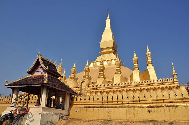 gold-covered large Buddhist stupa, Pha That Luang, Vientiane, Laos stock photo