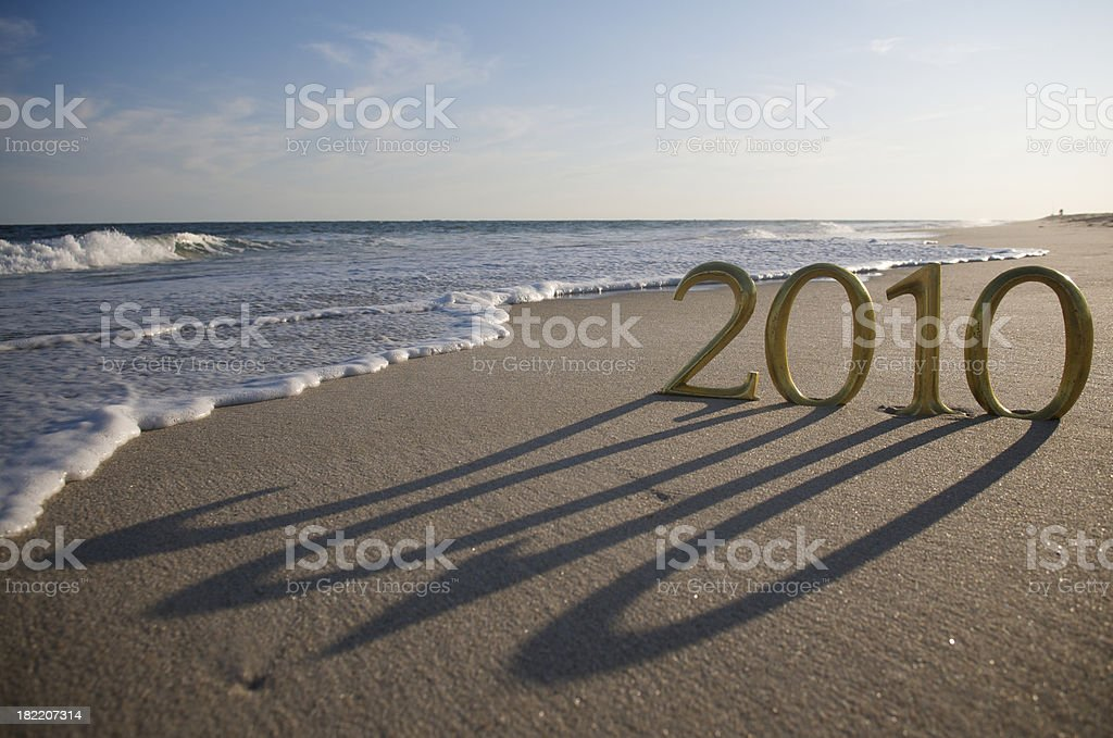 Golden 2010 Casts Shadow on Beach royalty-free stock photo