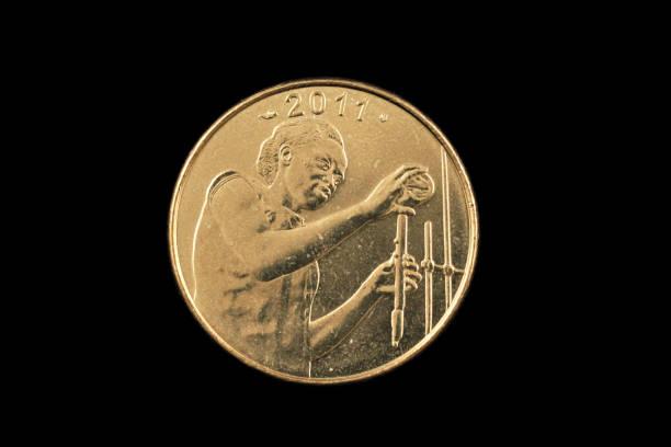 25 westafrikanischer franc goldmünze - imperialismus stock-fotos und bilder