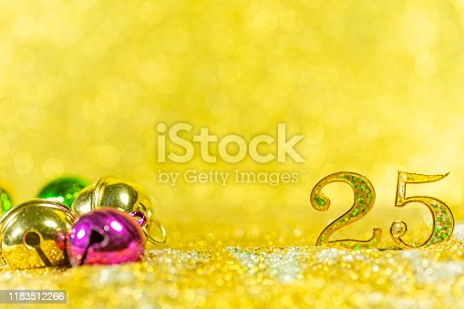 istock Golden 3d number 25 with festive confetti and spiral ribbons. Poster template for celebrating anniversary event party. 3d render,Gold glitter lights bokeh background. 1183512266
