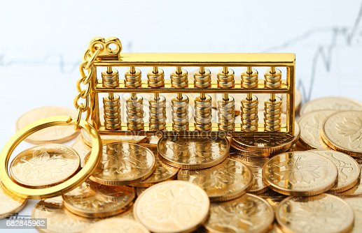 istock Golden Abacus with Chinese rmb gold coins as background 682845962