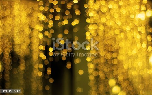 istock Golden abstract bokeh, blur light background. Beautiful and luxury background. Christmas wallpaper. 1263507747