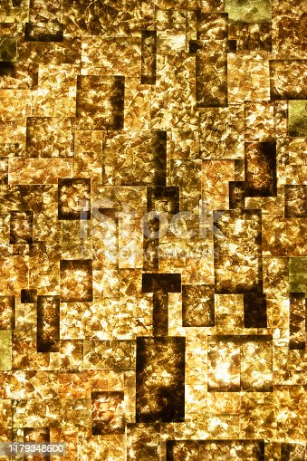 512401542istockphoto Golden Abstract wall background. 1179348600