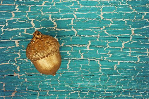 istock golden acorn on old plank 522478070