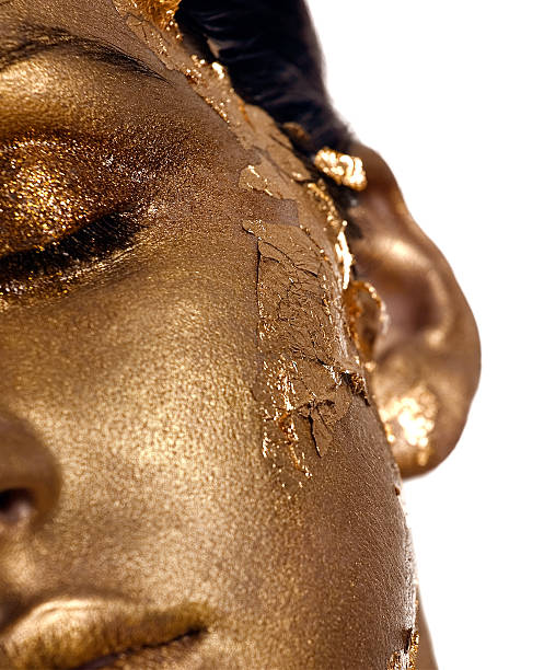 Golden Age Female model in golden bodypaint. body paint stock pictures, royalty-free photos & images