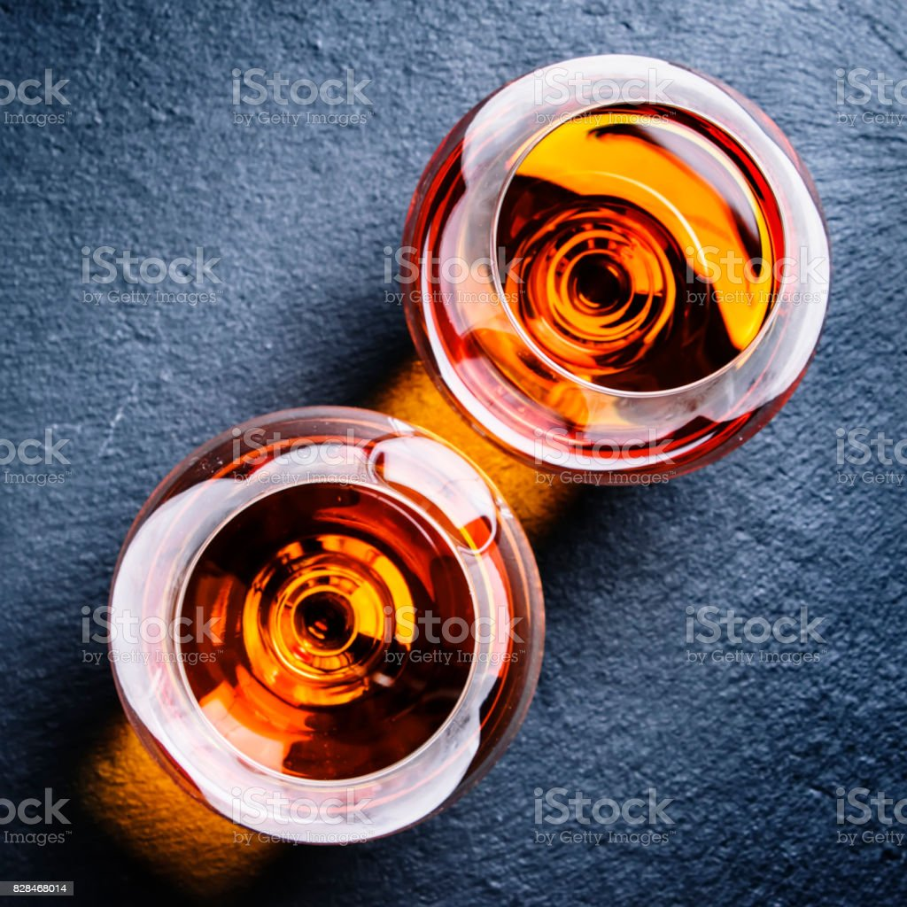 Golden alcohol strong drink in a glasses, top view stock photo