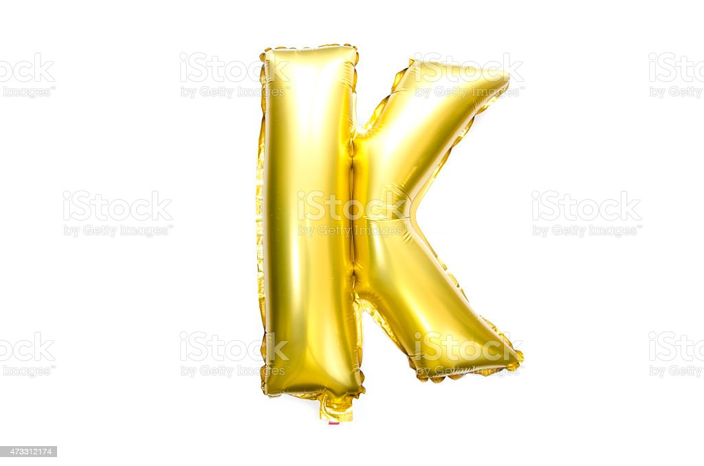 Golden Alphabet Foil Balloon Letter K stock photo