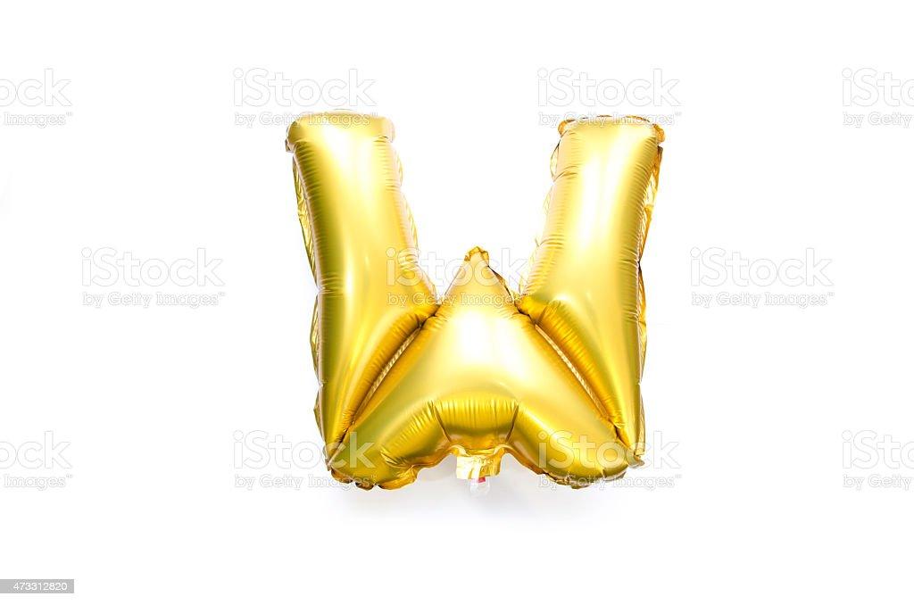 Golden Alphabet Foil Balloon Letter W stock photo