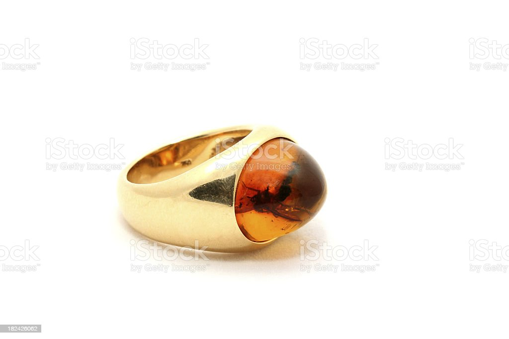 Golden Amber Ring with trapped Insect on White Background royalty-free stock photo