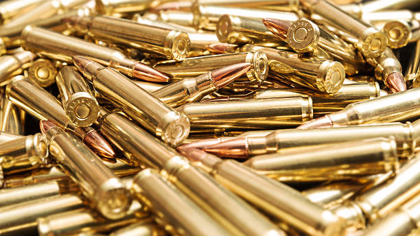 Golden ammunition Pile of golden rifle cartridges ammunition stock pictures, royalty-free photos & images