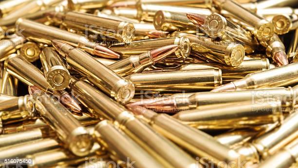 Pile of golden rifle cartridges