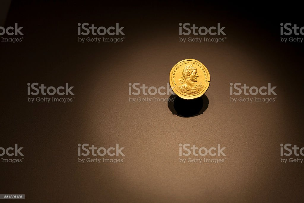 Golden Ancient Roman coin stock photo
