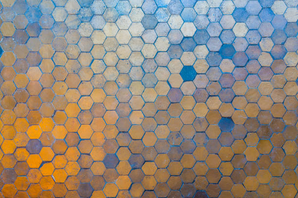 Golden and blue hexagon blocks on floor. Abstract background texture. stock photo