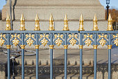 Golden and gray fence in Place de la Concorde in a sunny day in Paris, France