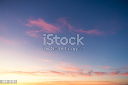 Wispy cirrus cloud above a golden sunset in Italy.
