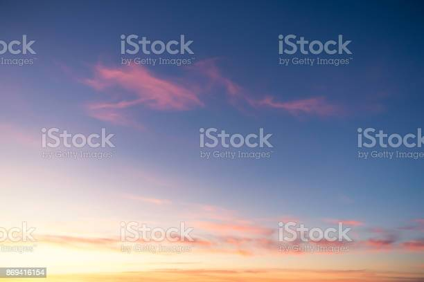 Photo of Golden and pink sunset horizon