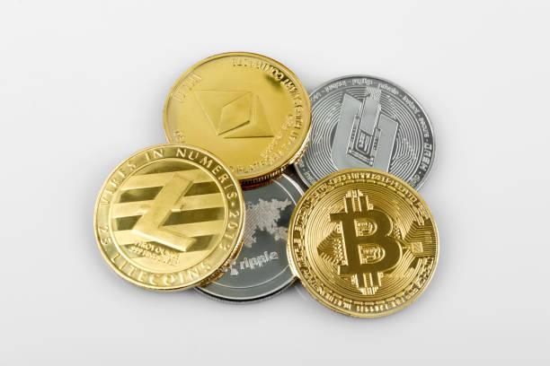 Golden and silver crypto moneys on white background stock photo
