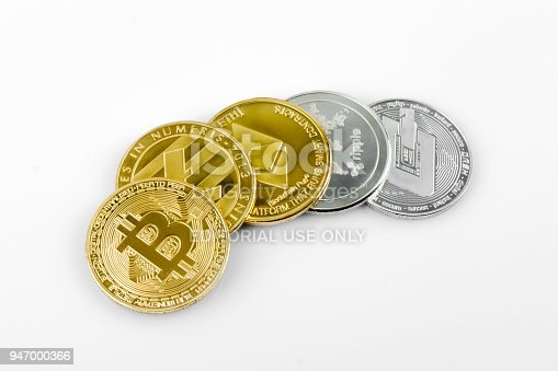 Antalya, Turkey - April 08, 2018 : Golden and silver crypto moneys on white background.
