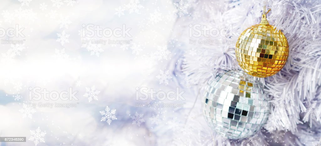 Golden And Silver Glitter Balls On White Fir Pine Tree And Bokeh