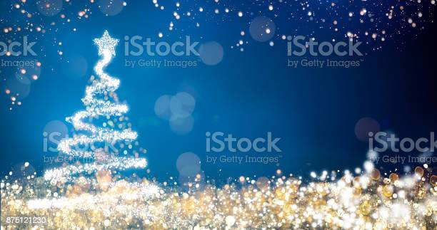Golden and silver lights with christmas tree on blue backgroundbright picture id875121230?b=1&k=6&m=875121230&s=612x612&h=wmk6umm1iquwm mlpjgdnw3vx9qu ruxdzdcdci6p4a=