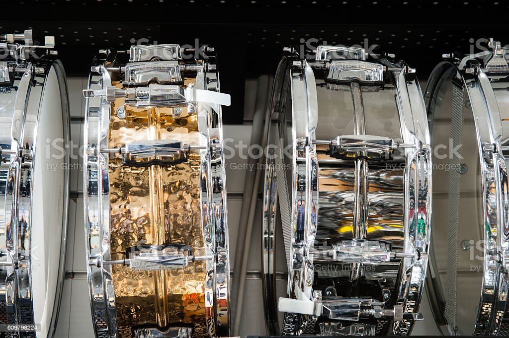 Golden and silver tomtom drum stock photo