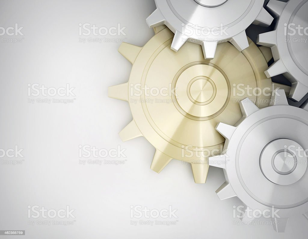 Golden and white gear stock photo