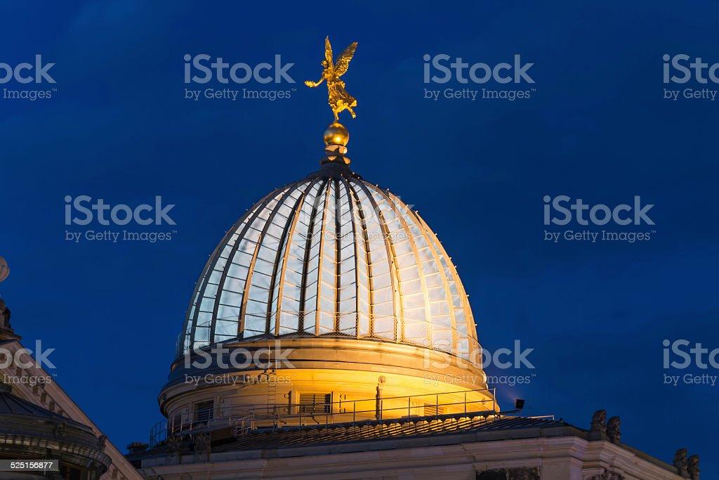Golden angel on the roof of the Kunstakademie Dresden stock photo