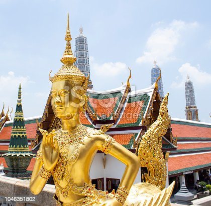 Golden Angel with Pagoda in Wat Pra Kaew, thailand
