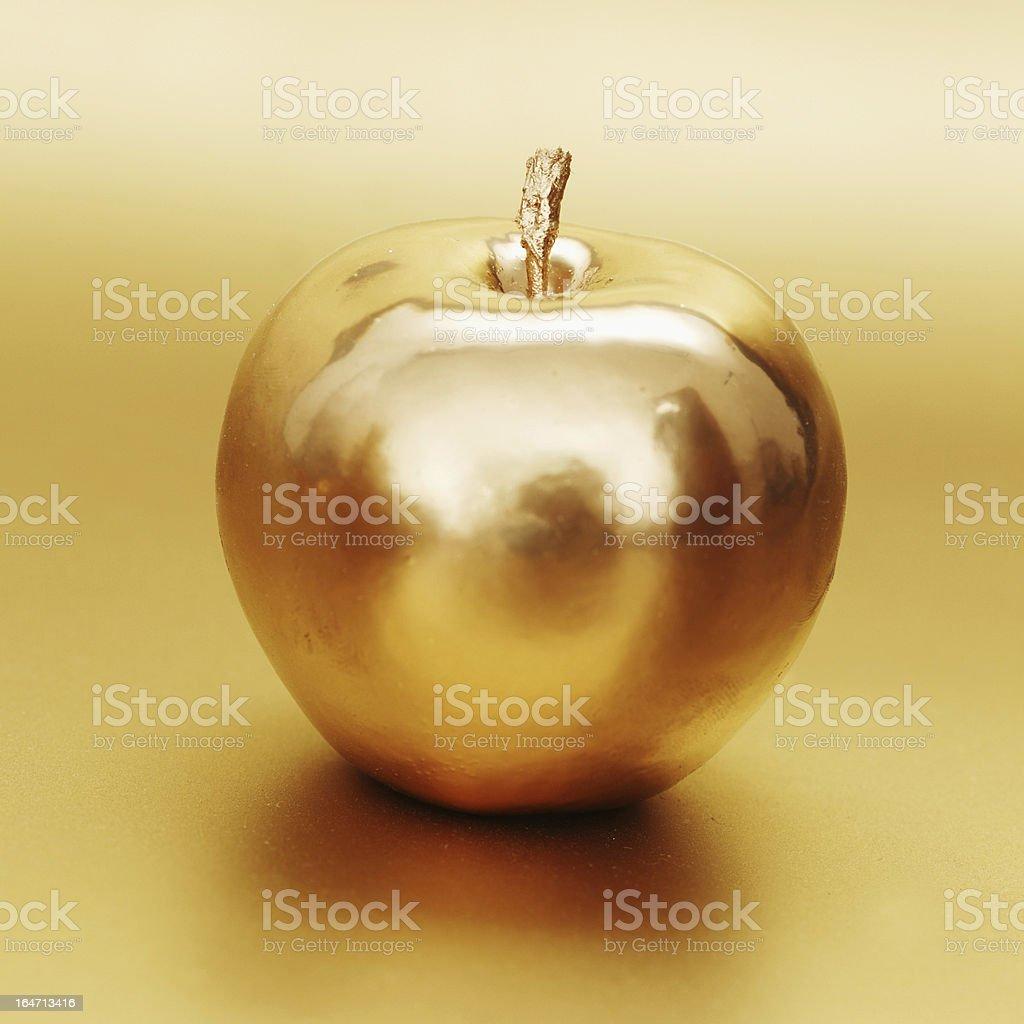 golden apple gold apple on gold background Apple - Fruit Stock Photo